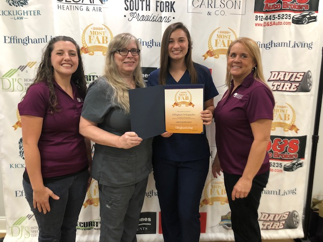 Effingham Orthopaedists Staff Accepts Award